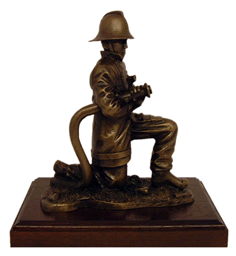 Fire Fighter on Branch Kneeling with Traditional Helmet
